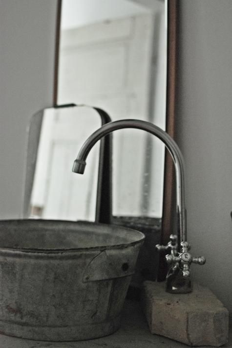 DIY: Galvanized Bucket as Bathroom Sink : Remodelista  http://remodelista.com/posts/diy-galvanized-bucket-as-bathroom-sink#