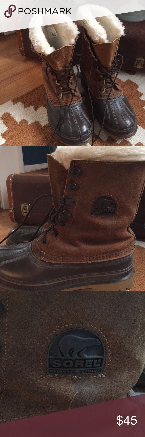 Brown Sorel Men's boots EUC. Insulated size 7 men's boots. Brown with fur around the calf. Lace up! Warm boots for winter. I wear a women's 9....they fit me. Sorel Shoes Winter & Rain Boots