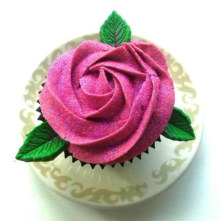 Chocolate cupcake with edible glitter raspberry vanilla buttercream rose & fondant leaves made by me