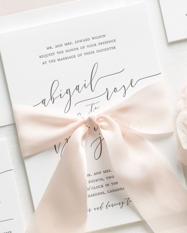 Letterpress Wedding Invitations with gorgeous modern calligraphy and a custom dyed 100% silk ribbon in pale pink. Click to shop our Romantic Calligraphy Letterpress suite!