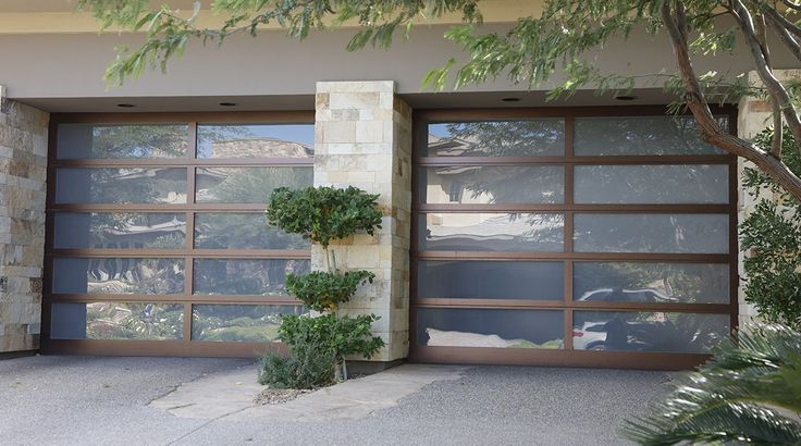 With Bronzed Garage Door Panel Frames These Glass Doors Stand Out As A Contempo Contemporary And Mode Garage Doors Glass Garage Door Garage Door Panels