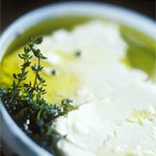 Marinated mild and creamy feta cheese with herbs and whole peppercorns