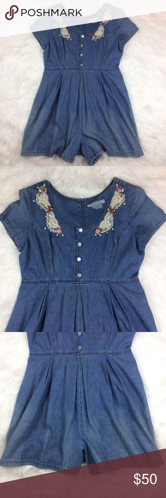 "Vintage 90's Denim Jean Romper Floral Lace Pearls Vintage ASHLEE Denim Jean Romper, One Piece, Shorts w/ Lace, Pearl, & Floral Applique. Hand Pockets. Zip-up Back. Tacked in Shoulder Pads That Can Be Kept or Removed, 80s/90s. Very ""Kelly Kapowski.""  VINTAGE Size 14, SEE MEASUREMENTS BELOW AS VTG SIZES ARE SMALLER THAN CURRENT SIZES. One Seam Ripping Out at Back of Arm, Not a Hole.  MEASUREMENTS LAYING FLAT:  Pit to Pit: 20.5"" Waist Laying Flat (at Seaming): 17.5"" Rise (Crotch to Seamed…"