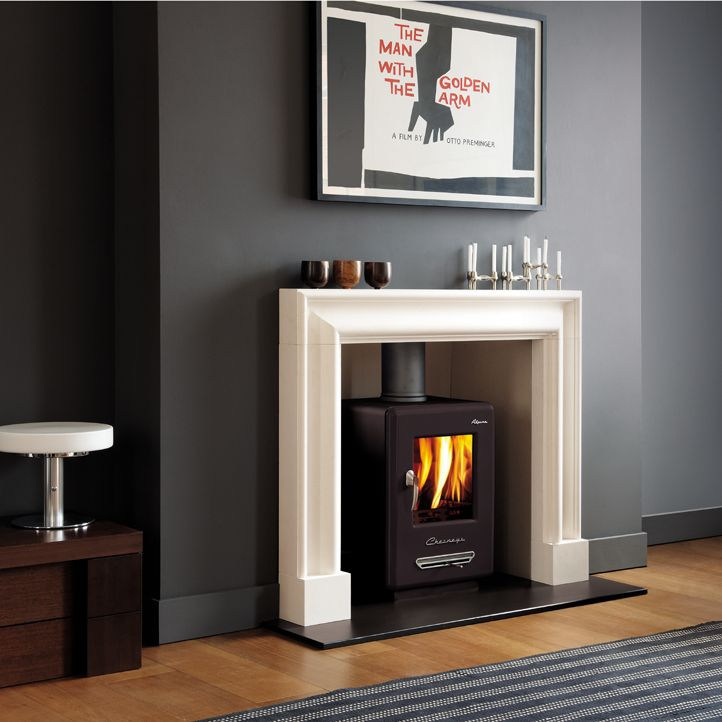 Wood burning stove, white fireplace, grey walls... But male, nice simplicity