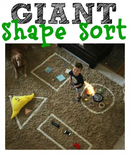 A little masking tape and objects around the house can turn into a fun learning game for toddlers! This GIANT shape sort activity is perfect for teaching shape recognition . . . with a little cognitive development skill of sorting on the side!