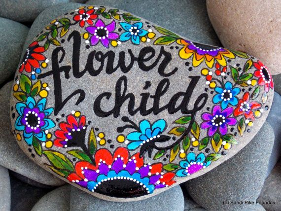 flower child. hippie. peace. child of the sixties. wildflowers.  painted rock (sea stone) from Cape Cod.  A beautiful, soft gray stone, worn