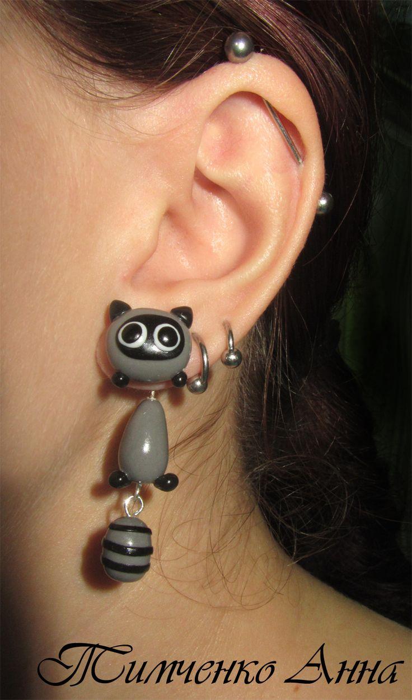 HM polymer clay raccoon earrings.