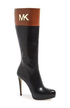 "Monogrammed hardware lends signature style to a platform leather boot crafted with Michael Kors' refined sensibility.5"" heel; 1"" platform (size 8.5). 13 3/4"" shaft. Side-zip closure. Lea..."