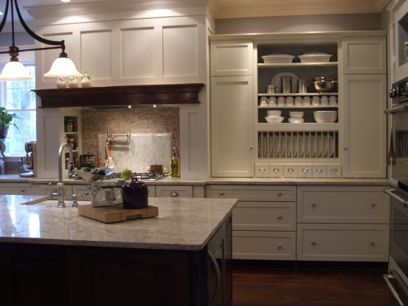 Believe it or not... this kitchen was done on a tight, low budget. I absolutely LOVE how she was able to make the stock cabinets look high-end with some clever designing (plate rack, little apothocary-like drawers, and only drawers for base- no base cabinets with doors). <3 swoon