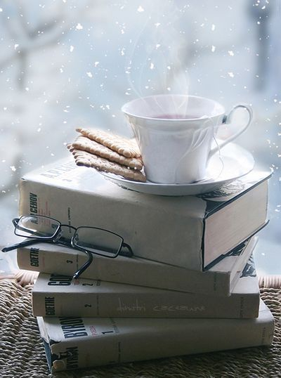 tea and books; four of my favorites all together: books, tea, snow and BOKEH!!!!