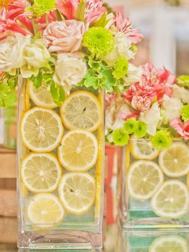 Bright floral arrangements always make for beautiful centerpieces. Add an unexpected — and super springy — twist by lining your vases with lemon slices.