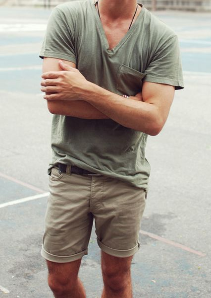 Shop this look on Lookastic:  http://lookastic.com/men/looks/olive-v-neck-t-shirt-dark-brown-leather-belt-tan-shorts/11005  — Olive V-neck T-shirt  — Dark Brown Leather Belt  — Tan Shorts