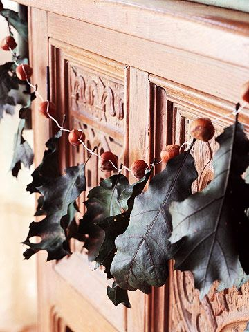 Natural Garland  Adorn your mantel with an ode to the changing seasons. Gather colorful leaves and acorns or walnuts from your yard or find them at a crafts store. Drape them on your mantel, along a staircase, or over a curtain rod.  How to: Thread leaves and nuts on string or twine to form a garland. Space them out or bunch them together, depending on how you want the finished product to look.