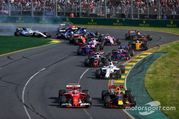 Kimi Raikkonen, Ferrari SF70H and Max Verstappen, Red Bull Racing RB13