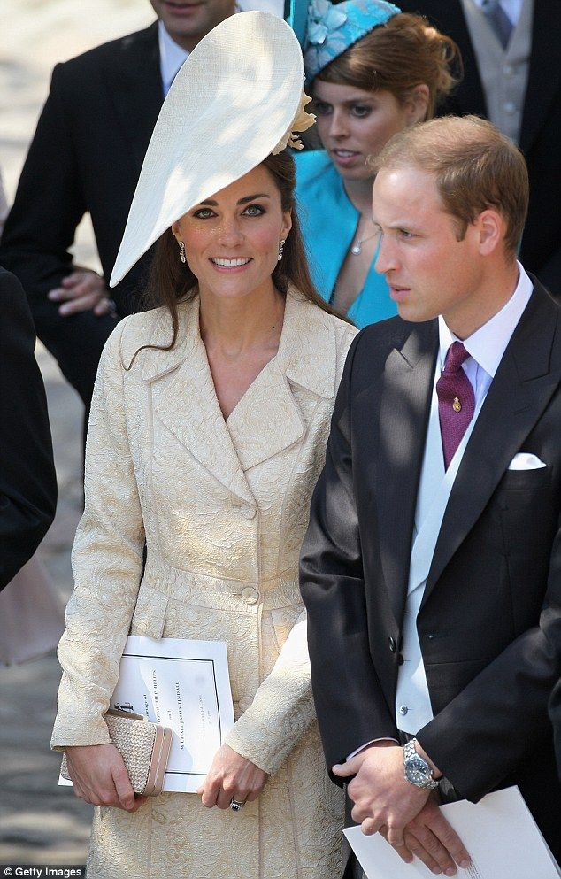 The Duke and Duchess of Cambridge, attend Zara's Phillip's wedding. Catherine wore a favourite coat, a DAY Birger cream brocade coat, paired with her LK Bennett 'Sledge' pumps. Her striking hat was designed by Gina Foster and was a gift from her husband.