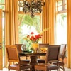 Warm Color Schemes  Elegant Color Scheme: Butterscotch + Chocolate  The sunny splendor of a Tuscan sunset inspired the decor in this lovely dining area.