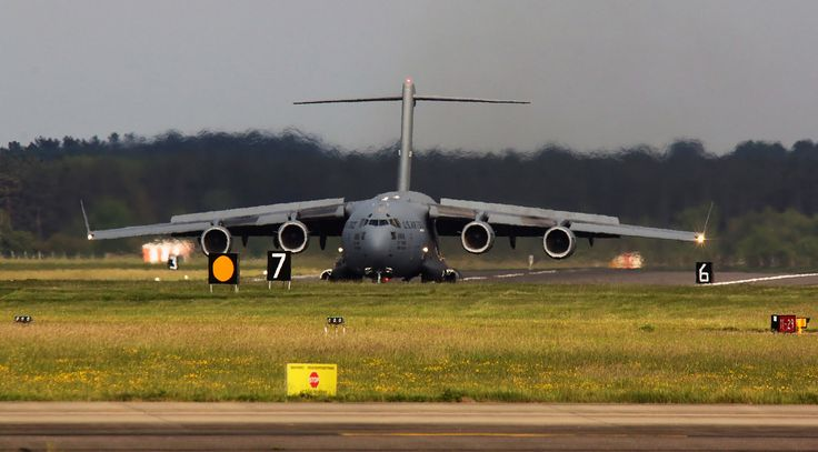 https://flic.kr/p/U7w9Jq | At sixes and sevens | Travis AFB California based Boeing C-17A Globemaster III 06-6164 from the USAF's 60th/349th Air Mobility Wing dumps the lift and engages full reverse thrust as she touches down at RAF Mildenhall  In as 'Reach 699' she was one of two 'Mooses' there that day amongst all the other traffic that uses this busy Suffolk airfield.  Slated for closure in a few years time it seems hard to fathom why given the infrastructure and volume of activity there…