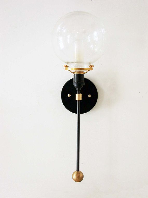 This Modern and Mid Century inspired vertical clear globe fixture is a unique design piece handmade and handcrafted with sustainable materials in our studio. It will make a great center piece for your modern home or traditional decor. As well, it will add lovely charm to your living room, bedroom, kitchen, foyer, mud room, powder room or home office. All brass parts are solid brass, not plated. They are degreased, cleaned and coated with natural Bee's wax to slow oxidation / patina over time…