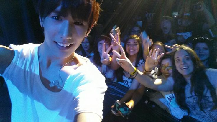 Minwoo taking a selfie with fans with my phone!!!!