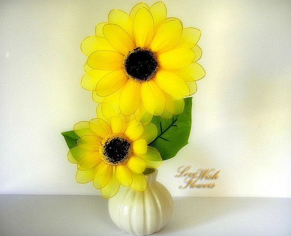 Beautifully artificial yellow sunflowers are very lovely. Handcraft nylon fabric flower for home decor. Floral arrangement