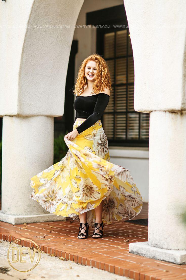 Senior picture portrait ideas maxi skirt off the shoulder velvet top redhead arch twirling