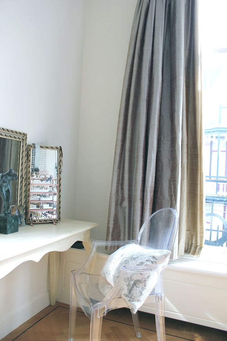 ghost chair and vanity table with a triptych mirror and gorgeous silk drapes