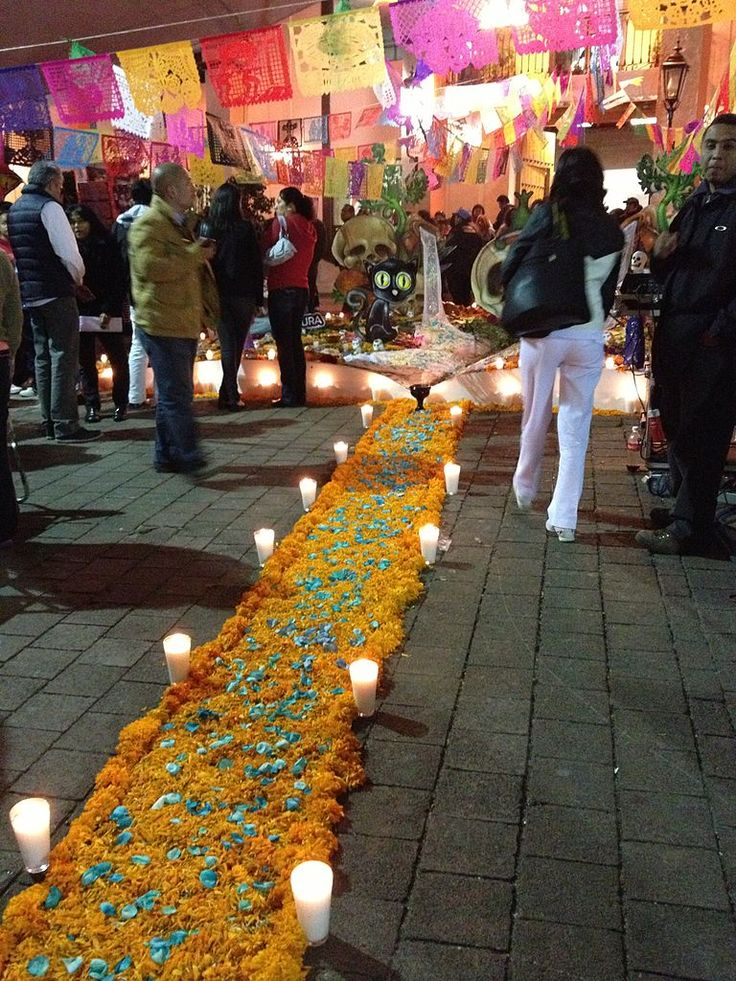 "Day of the Dead, Mexico - It is traditionally believed that the smell of the ""flor de cempazuchitl"" guides the deceased to the ofrenda 