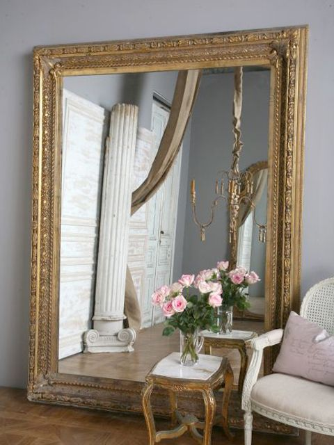 Dynamic large mirrors add grounded touch a room while adding vertical lines making the room appear taller. Place them properly and the reflection of natural light can warm up any room