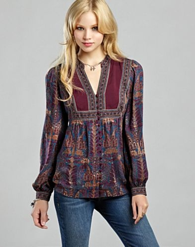 Not thin or white like most peasant tops. I like it, though I'm not sure about the sleeve poof/cuffs. (Lucky Brand)