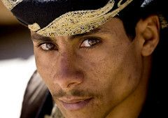 (Tribes of the World) Tags: voyage travel portrait man smile vertical outside outdoors saba bahrain desert outdoor main uae middleeast east saudi arabia yemen kuwait kindness middle oman sourire saudiarabia humanbeing array homme qatar beduin bedouin confidence contemplation ksa arabs yemeni arabians shemagh threepeople socotra exterieur lookingatcamera moyenorient onlymen colorpicture waistup himyarite hadhramaut kingdomofsaudiarabia semetic photocouleur arabiesaoudite arabscarf semites…