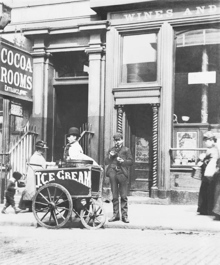 Ice cream sellers became a common sight on British streets in Victorian times, offering 'penny licks' (scoops of ice cream in glass bowls, which would be licked out and reused) to the public. This street seller is working on Richmond Row in Liverpool, circa 1895. (Getty Images)