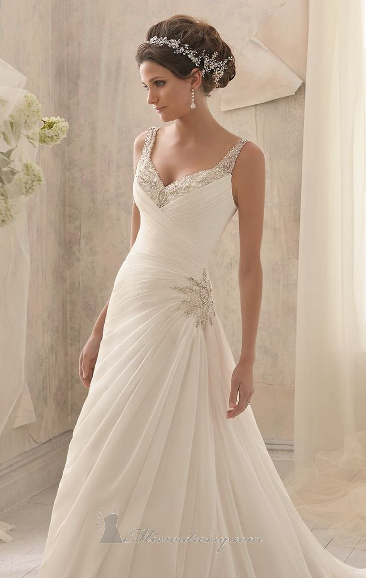 Make an impression in 5213 by Blu by Mori Lee. An elegant wedding gown in delicate chiffon. The pleated bodice features a v neckline with ta...