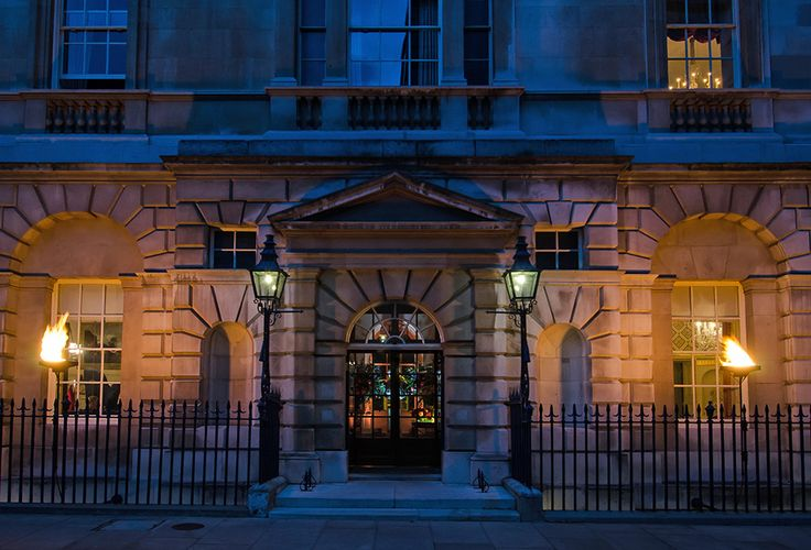 A prime location in St James's London, the entrance to Spencer House lit by flambeau for an evening reception.