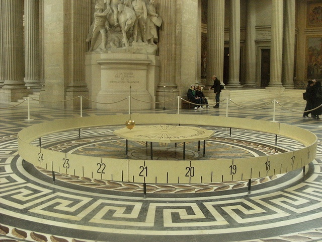 Foucault's Pendulum - draws in the sand and tells the time as well. I like that the clock is also the barrier. Suspend pendulum from a very high point.