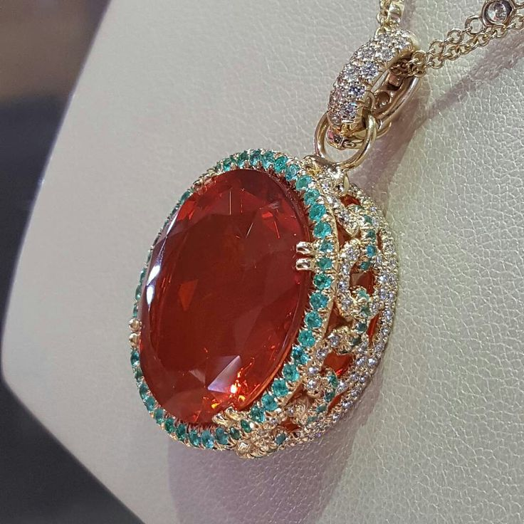 Stunning color, 17ct FIRE OPAL surrounded wiith Paraiba Tourmaline and diamonds. Geetered coffeeFIEND/treasure island (JackLewisJewelers)