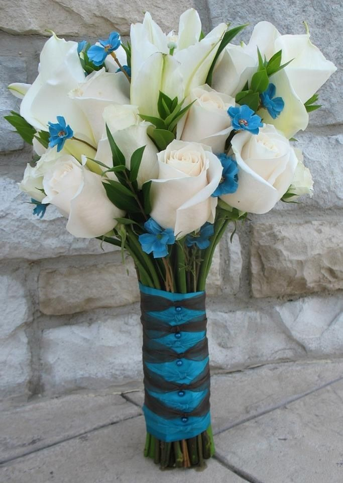 Teal wedding. White Roses and Calla Lillies with blue accent flowers
