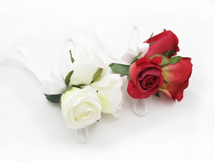 Red and white garden roses wristlets. Find your perfect wedding flowers at www.loveflowers.com.au