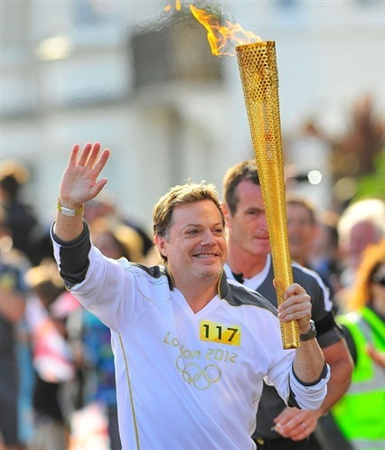 Eddie Izzard carrying The Olympic Torch