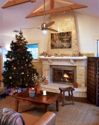 A limestone fireplace centers this Austin, Texas, living room, decorated for the holidays.