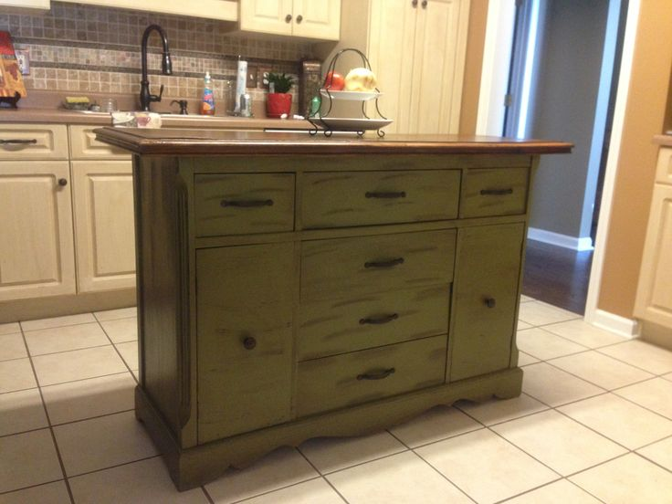 Repurposed antique buffet made into kitchen island. | For