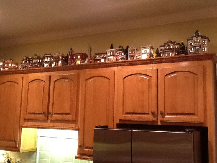 christmas village on top of the cabinets christmas