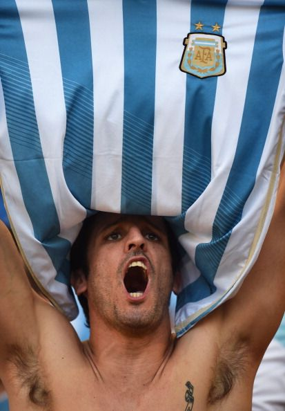 An Argentina fan enjoys the atmosphere prior to the 2014 FIFA World Cup Brazil…