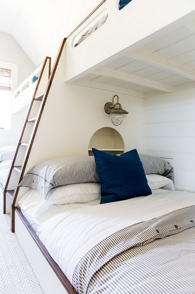 Bunk beds with nautical lighting and built in bookcase. White Bunk beds with alder trim, nautical lighting and built in bookcase #WhiteBunkbeds #Bunkbeds #aldertrim #nauticallighting #builtinbookcase Timberidge Custom Homes