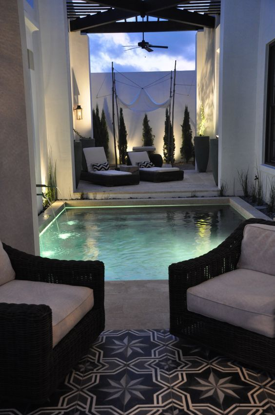 tiny outdoor square pool with a waterfall