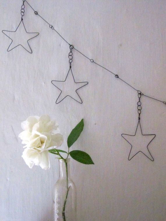 Garland of 5 stars wire on Etsy for $48.00 - I need to figure out how to do this myself... Would be so pretty on the mantel
