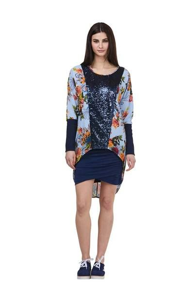 Stunning floral print top with navy sequin through body and navy ribbed sleeve Also available in a Dress Length  Standard fit Poly blend Model is 5'9 and is wearing a size S