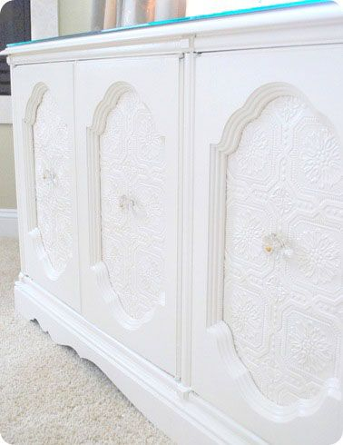 Cabinet makeover with paintable wallpaper, via centsationalgirl
