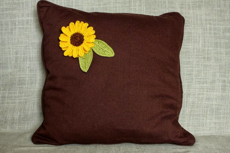 Brown pillow with sunflower