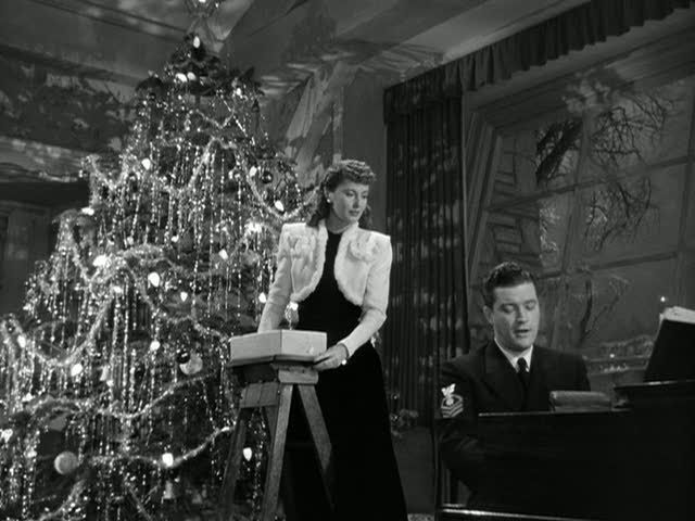 """Although a movie set for Christmas in Connecticut, I love the """"room"""" as a whole. Large windows, stone, and that tree! :)"""