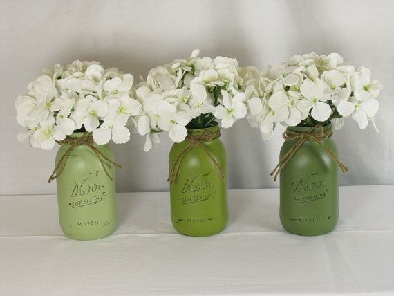 Green painted mason jars for wedding centerpieces. Rustic and shabby chic. #EuphoriaRoad #WeddingStuff Blog at www.creativeweddingstuff.com